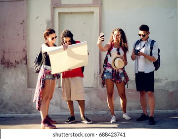 Group of touristic friends are preparing for next step. - Shutterstock ID 688423741