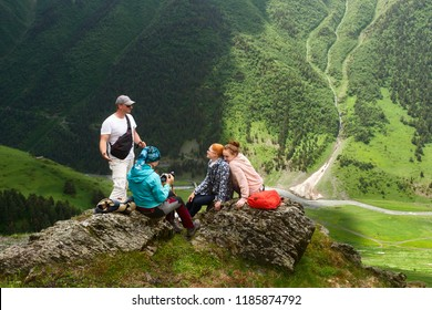 Group of tourists enjoying during summer vacation in mountains near old ancient village Dartlo. Tusheti, Georgia(country)