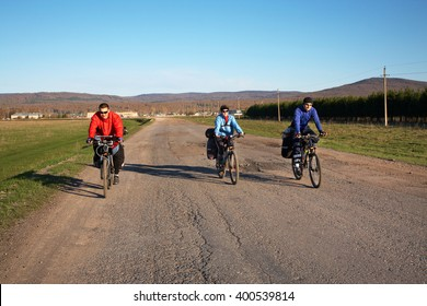 group of tourists in a hike on bicycles with backpacks. travelers on bikes. bicycle tourism