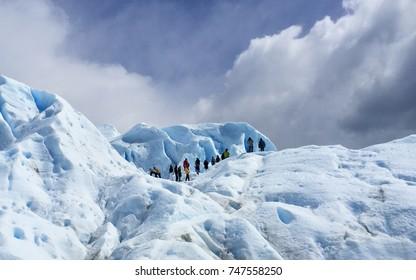 Group of tourists joining glacier treks in a famous Perito Moreno Glacier in Los Glaciares National Park, Argentina