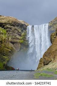 group of tourists near Skogafoss waterfall, Iceland
