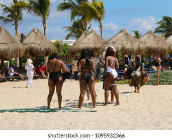 Group of tourists on a tropical beach.