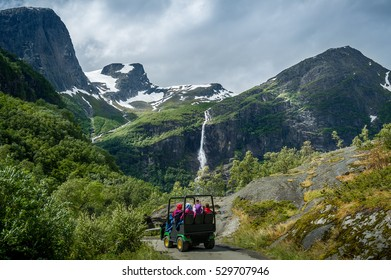 Group of tourists in the special excursion troll car on it's way to Briksdalsbreen glacier viewpoint. Briksdal, Norway.