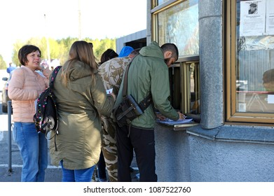 Group of tourists standing in front of a window of passport check point of crossing point Dytiatky. Press-tour to Chernobyl Nuclear Power Plant for mass-media. April 20,2018. Dytiatky, Ukraine