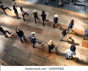 Group of traditional western folk music dancers view from above blur dynamism effect Turin Italy March 24 2019
