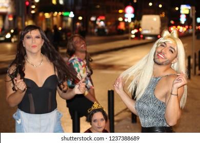 Group of transvestites at night