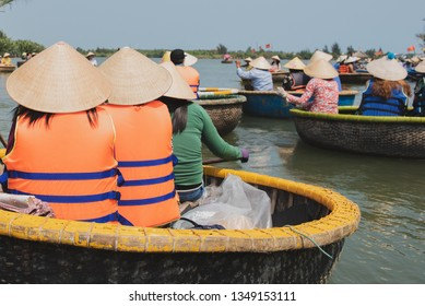 Group of traveller people sitting in the Vietnam traditional bamboo basket boat in the canal at Da Nang, Vietnam.