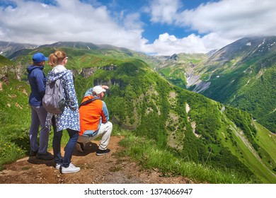 Group of travellers enjoying view mountains during summer vacation in Georgia (country).
