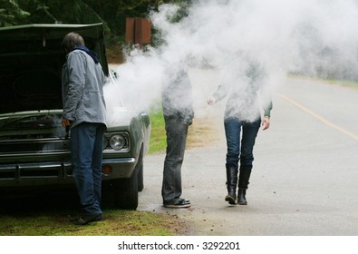 A group of travellers wonders what to do after their car overheats.