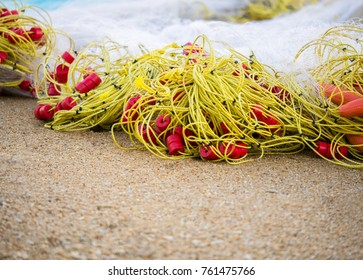 Group of Trawl nets piled on the beach. Preparing the brings up the boat.and Use it the catch all the fish