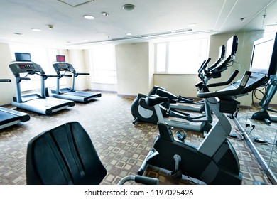 Group of treadmills in modern gym