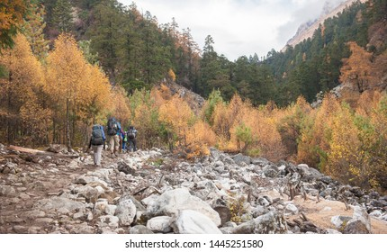 A group of trekkers heading to Samagau valley on Manaslu circuit with view of Mount Manaslu range 8 156 meters. Himalayas, stone buildings in village, at Manaslu Glacier in Gorkha District in Nepal