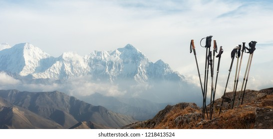 Group of trekking sticks on background mountains range in Himalaya (Upper Mustang). Panoramic view.