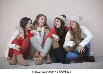 group of trendy happy teens smiling and laughing