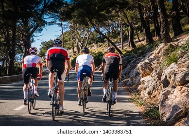 Group of triathletes on road bicycle, sport photo in nature. Majorca, Spain
