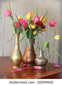 Group of tulips on the wooden table : copper flower vase - startupinsights.org
