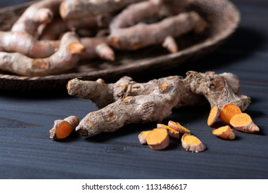Group of Turmeric (Curcuma) on wooden table, herbal ingredient use for food and medical. Selective focus