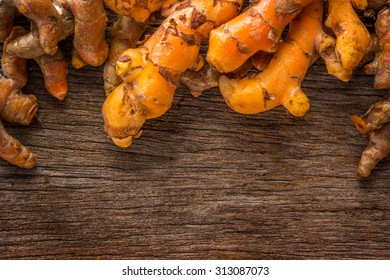 Group of turmeric on grunge wooden background.