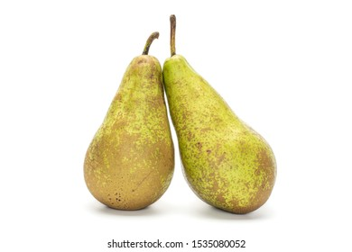 Group of two whole fresh green pear conference isolated on white background