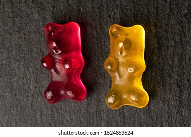 Group of two whole gummy bear flatlay on grey stone