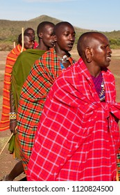 Group of unidentified Maasai men on Oct 15, 2012 in the Maasai Mara, Kenya. Maasai are a Nilotic ethnic group of semi-nomadic people located in Kenya and northern Tanzania