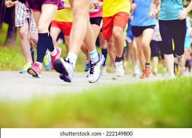 Group of unidentified marathon racers running, detail on legs