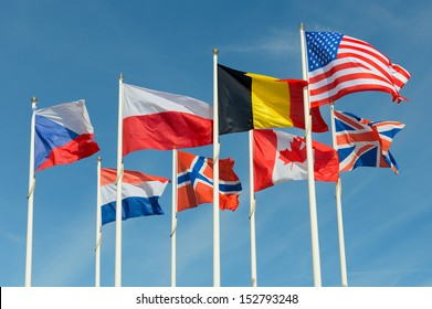 group of united flags on a blue sky background