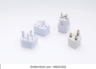 Group of universal plugs adapters isolated on white background.