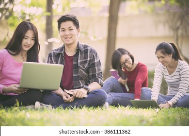 Group of university students having fun outdoors