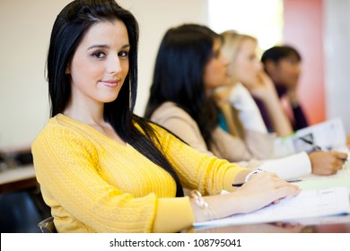 group of university students sitting in classroom
