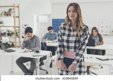 Group of university students studying in classroom.