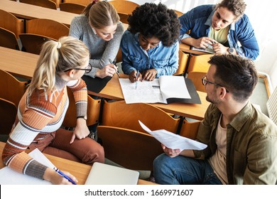Group of university students taking a test in a classroom.Educational concept.