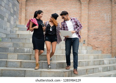 Group of university students walking down the stairs in university. Friends and college community concept.