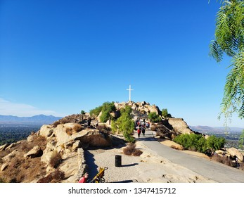 group of unknown hikers walking towards the cross at the peak of mount Rubidoux, september 30,2018,riverside ,california
