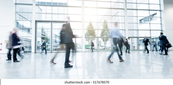 Group of unrecognizable business people at a trade fair floor