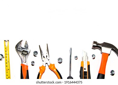 Group of used mechanical tools on a white background. With place for text, top view.