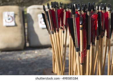 Group of used old red wooden arrows.