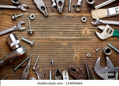 Group of used tools on wood background