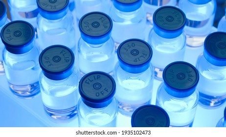 Group of Vaccine bottles. Medicine in ampoules. Glass vials for liquid samples in laboratory.