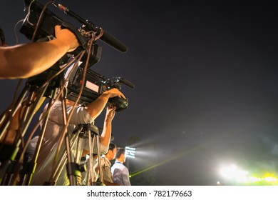 Group of video camera men at night event