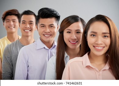 Group of Vietnamese young people smiling and looking at camera