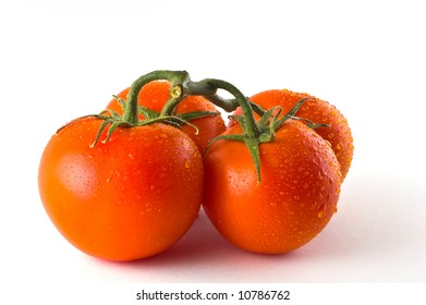 A group of vine ripened tomatoes against white background