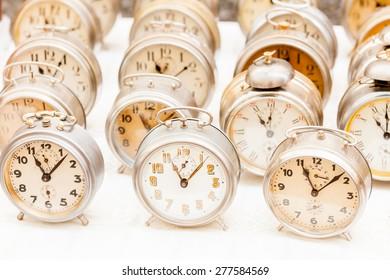 Group of vintage clocks at market