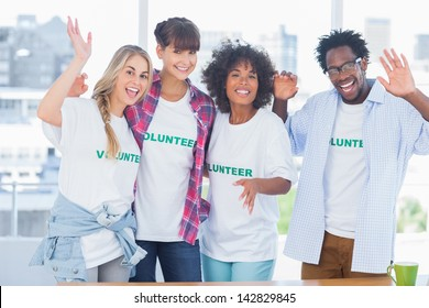 Group of volunteers standing together in a modern office