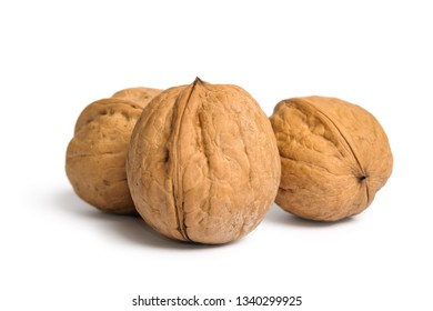 Group of walnuts in shell isolated on white background