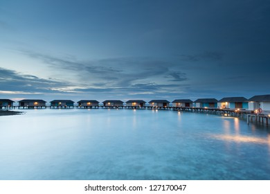 group of water bungalow short after sunset, malediven