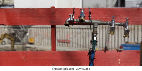 A group of water taps on a construction site