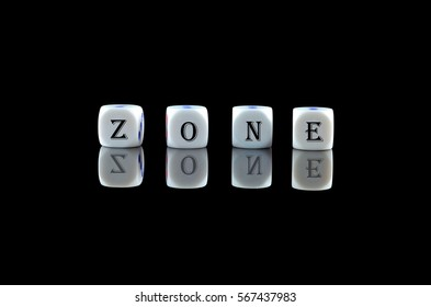 Group of White dice over black background with word written ZONE
