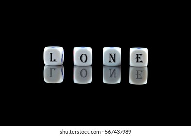 Group of White dice over black background with word written LONE