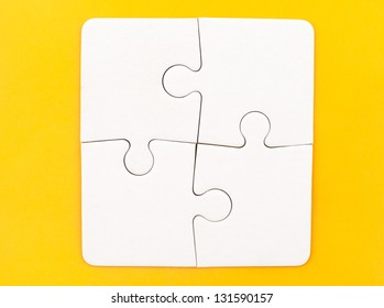 Group of white paper jigsaw puzzles